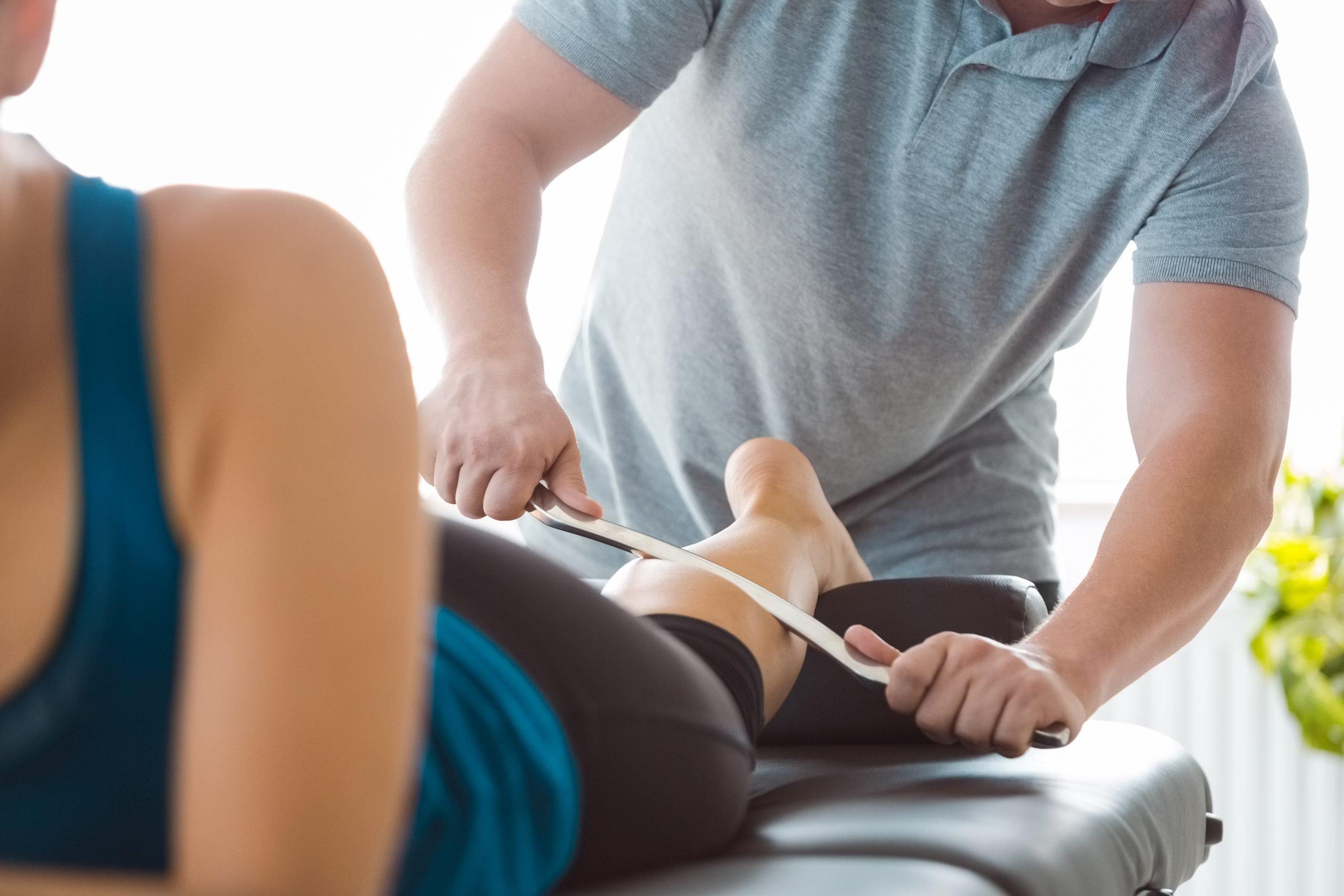 Physiotherapist massaging woman